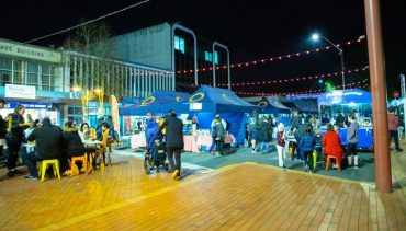 Market with people at night